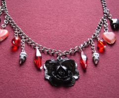 Gothic Rose - a charm necklace by SneddoniaDesigns