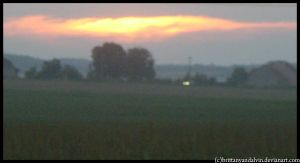 Sunset over fields by brittanyandalvin