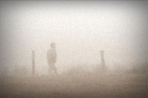 A silhouette walking past in the mist by April-Mo
