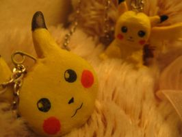 two pikachu necklaces by xShadowBunny