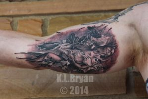 Raven girl tattoo on inner biceps by danktat