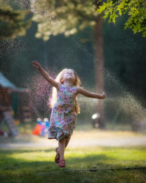 The Joy of Sprinklers in the Sun by swiftmoonphoto