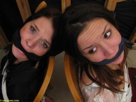 two gagged girl looking to me by deltorto